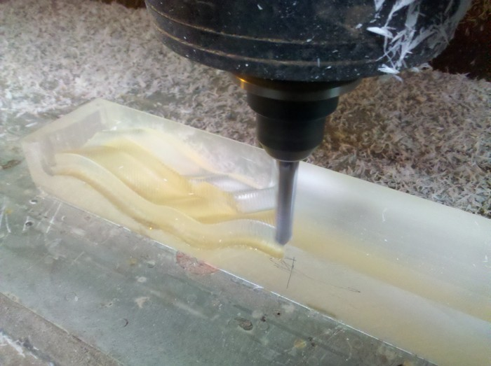CNC machine cutting out the Crystal Bacon
