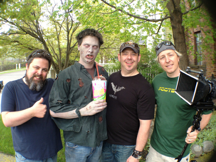 "Derek, Zombie (our good friend Jake!), Trevor, and Matt on location shooting the ""Love is Dead"" teaser."
