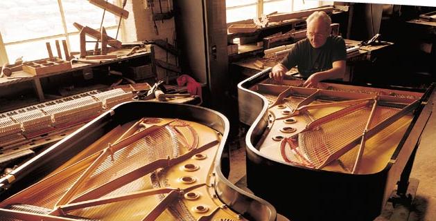 A Steinway artisan at work.