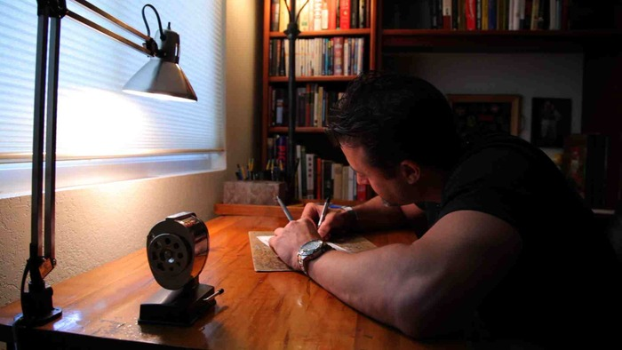 Stephan Pastis working on Pearls Before Swine
