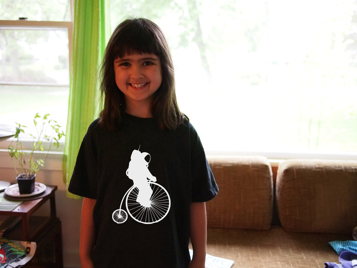 "The Bicycle Astronomy ""Astronaut on a Pennyfarthing"" T-shirt, 100% cotton and locally screen-printed."