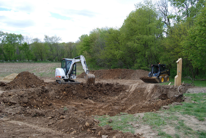 Rick, Matt, and Willaim take care of the excavation. Thanks to Garcia Consulting Engineers for the survey that helped us site our building.