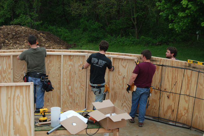 Will, Stephen, Matt and William install the formwork for the concrete walls.