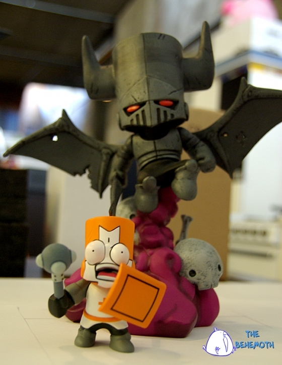 Here is a picture of our Necromancer figurine towering over the Bug-eyed Orange Castle Crashers knight figurine.