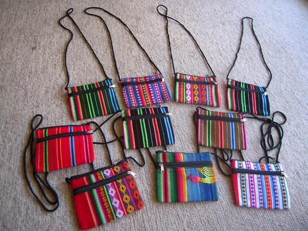 For $250 donation - a handmade wallet made of Bolivian aguayo (traditional indigenous weave)! (example pictured)~ Un monedero hecho de aguayo (artesanía Boliviana)!