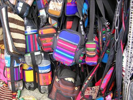 For $350  donation - a handmade bag made of Bolivian aguayo (traditional indigenous weave)! (example pictured)~ Una bolsa hecho de aguayo (artesanía Boliviana)!