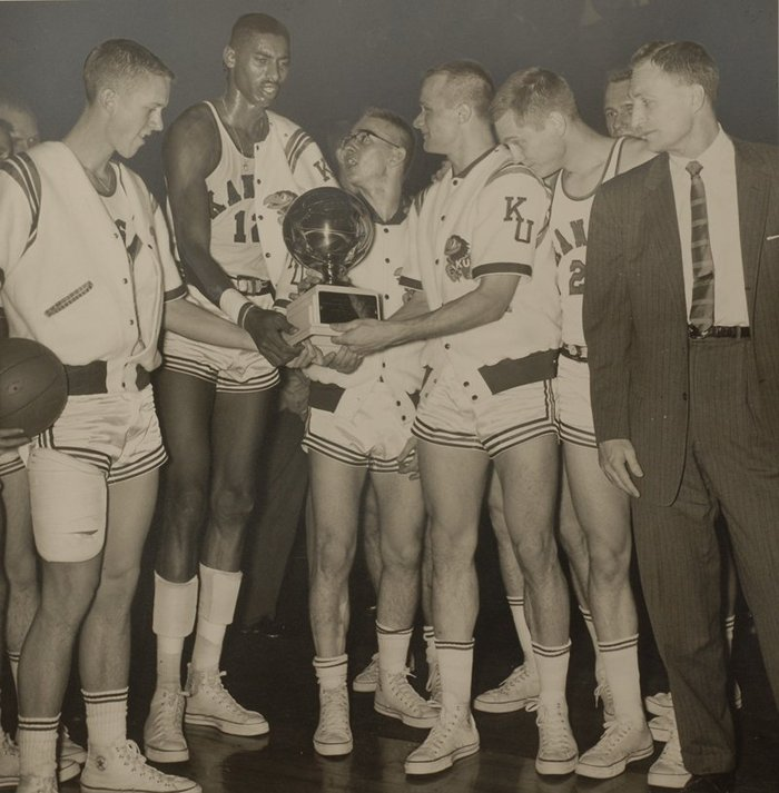 Kansas University sophomore Wilt Chamberlain, second from left, is among a cast of Jayhawks accepting the Big Seven Championship trophy in March of 1957.