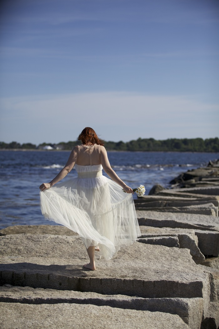 Stephanie Dumanski, played by Diana Porter, frolics in her wedding dress