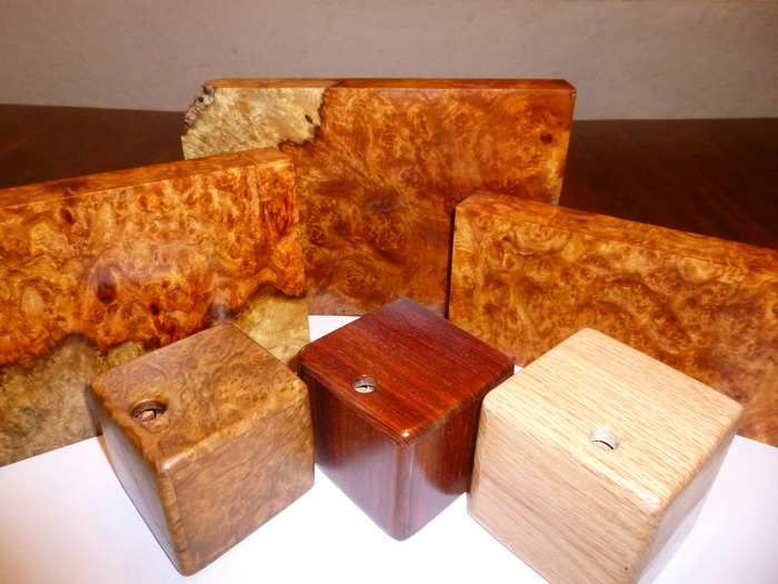 Just eye candy!  Amboyna Burl in back and in front from left to right Maple Burl,  Cocobolo, and Red Oak.