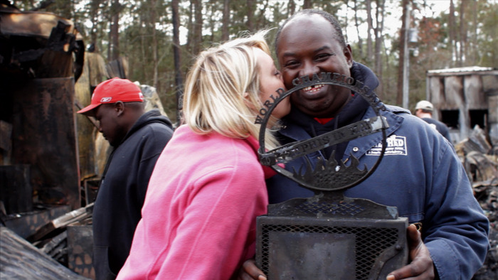 "Brooke gives Shed pitmaster Hobbs a kiss after he finds a burnt ""Memphis in May"" trophy in the wreckage"