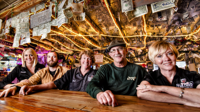 The Orrison family sitting at the bar in the original Shed (left-to-right: Brooke, Brett, Brad, Daddy-O & Momma Mia).