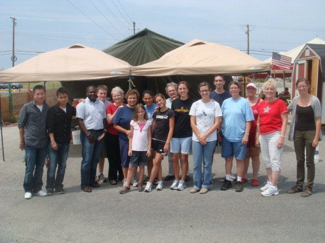 Thanh Nguyen, Huy Tran, Stacy Noland, (13) Volunteers, and Alyssa Philipps at the Relief Spark debris removal HQ in Joplin, MO,  July 2011.