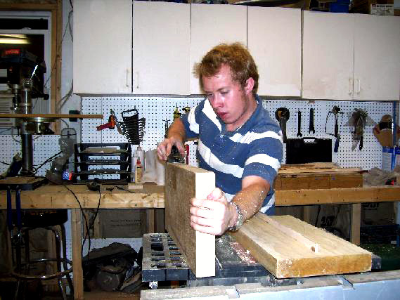 Shown Above: Me planing what would later become a guitar body, back in my guitar building days.