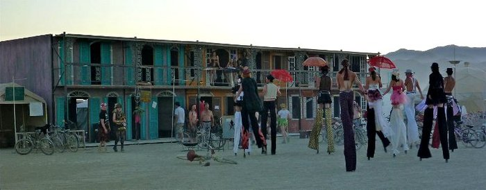 Stilt walkers looking for the upstairs stilt bar, captured by Kristen Lanum.