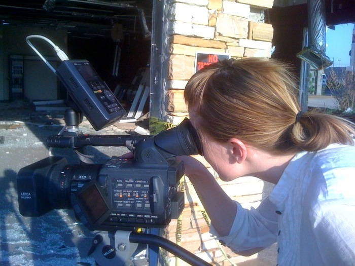 Nicole Sorochan setting up a shot in Tuscaloosa, AL, July 2011.  Photo by Stacy C. Noland.