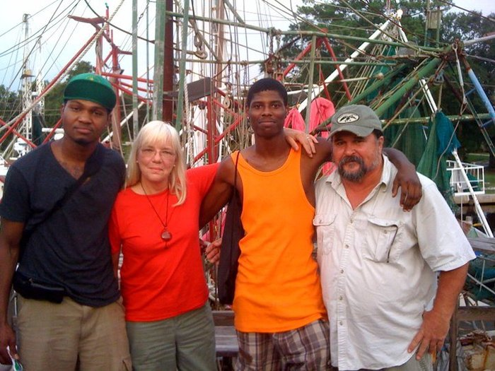 Solomon Simone, Peggy Denniston, Montrell Dickerson, and Greg Spies at Rodney's Marina in Bayou La Batre, AL, July 2010. Photo by Stacy C. Noland.