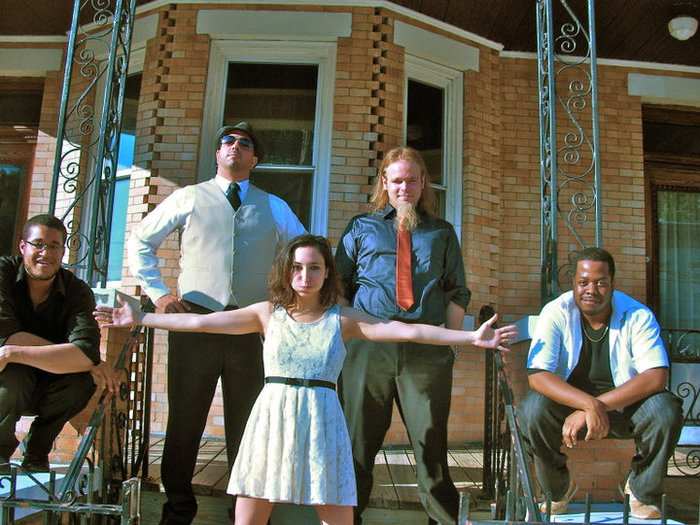 Our very first photo shoot! Before a gig, July 2010. (From left: Miles Lassi, ethnic percussion; Peter Bellomo, Bass Guitar; Sylvana Joyce, Keyboard and Vocals; Chris Smith, Guitar; Sean-David Cunningham, Violin.)