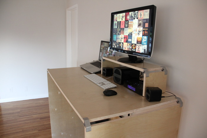 Standing desk (8), with monitor stand (12)