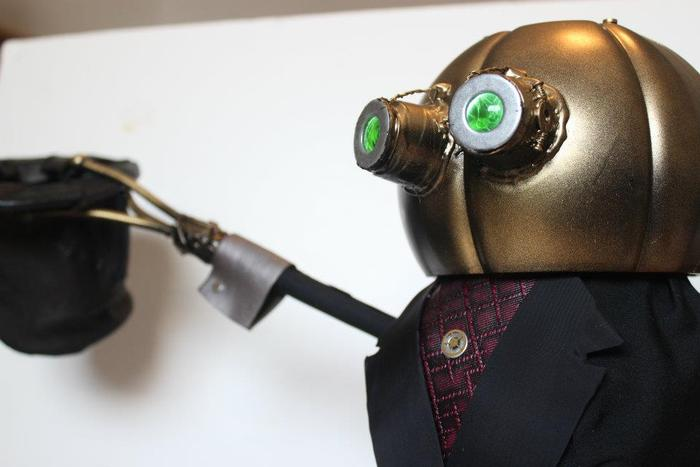 Robo-Butler... the most dangerous 16 inches of brass and tuxedo you will ever meet.