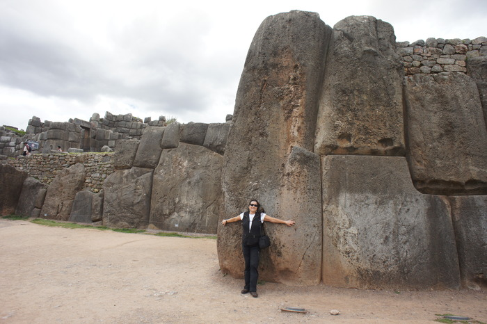 Maren Elwood in front of one of the biggest of Saqsaywaman's remaining stones.