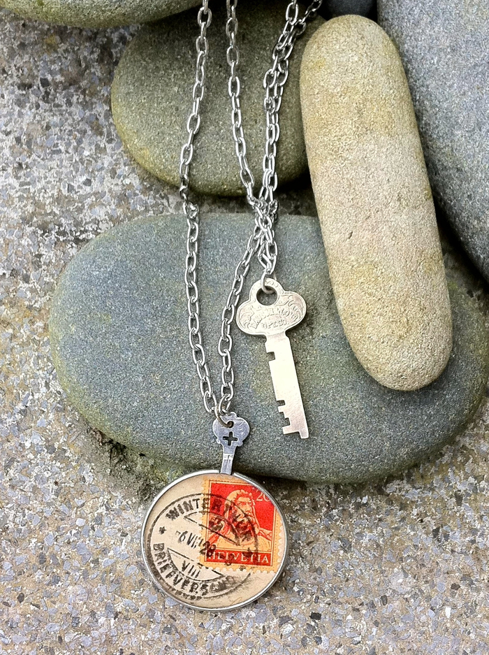 This double-stranded necklace features a vintage postcard and key.  Let me know if you'd like a prescription finding lens like the one you see here utilized in your necklace!