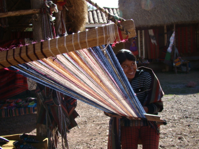 Huayllarqocha girl weaving traditional patterns into a table runner, like those that will be sent to our patrons.