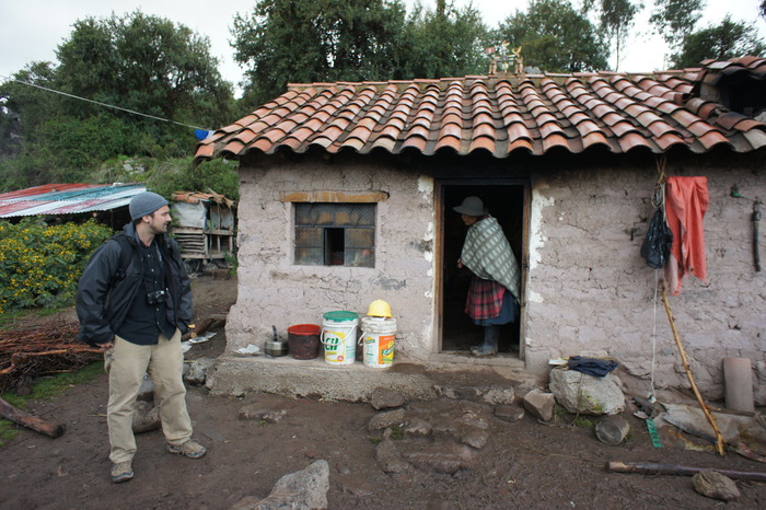 Ben Younkman, the host of the film, stands outside the home of Miguel and Paula Nina in Pucara; one of the communities participating in the project.