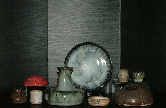 a bowl, vase and some miniature ceramics