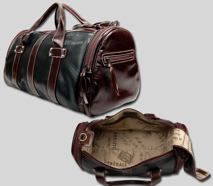 The Traveler - Available in brown or black leather trim, 22'' wide x 10'' high x 11'' deep