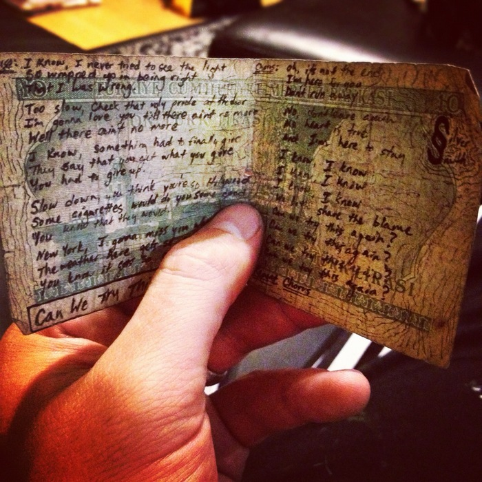 Handwritten lyrics on cash! Foreign, uncirculated cash, that is..