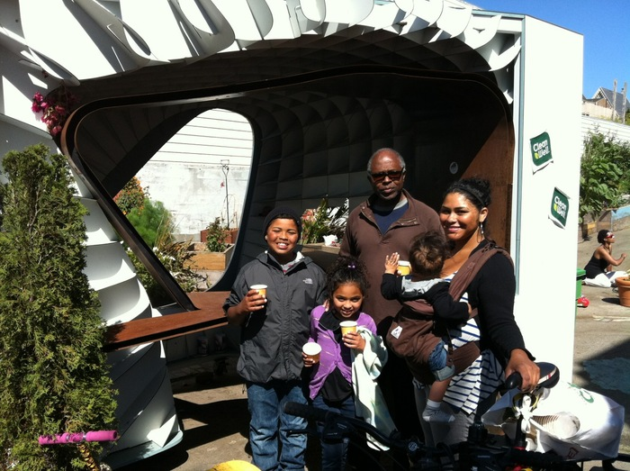 Beautiful, happy, local family sampling hot-hot Chai at the RHINOHOPPER Tea Garden during Sunday Streets Bayview, July 22, 02012!