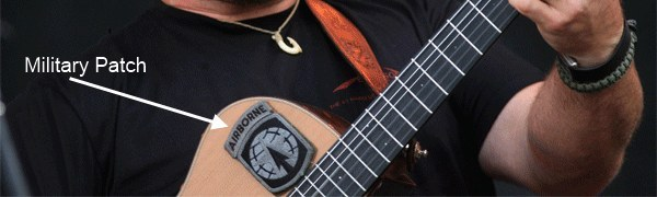 Military patch on Zac Brown's guitar.