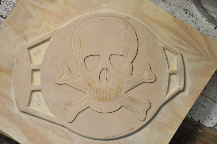 Skull pattern on a laser cut foundry matchplate.  The ovals on the side are the gates through which molten metal travels.
