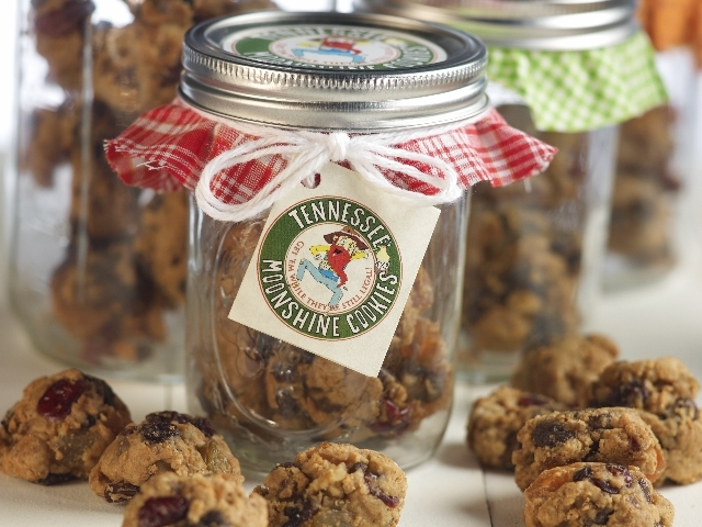 We pack six cookies in mason jars decorated with old-fashioned fabric