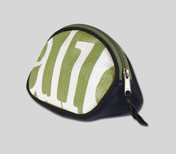 Toiletry Bag - available in different colors & designs of recycled Whole Foods store display banner. Black vegan leather binding with recycled inner tube and micro-suede stain resistant lining.