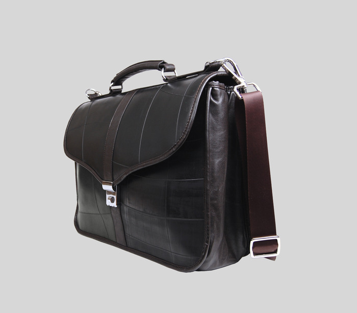 """Brief - available in black or brown vegan leather 17""""wide x 11""""high x 5""""deep."""