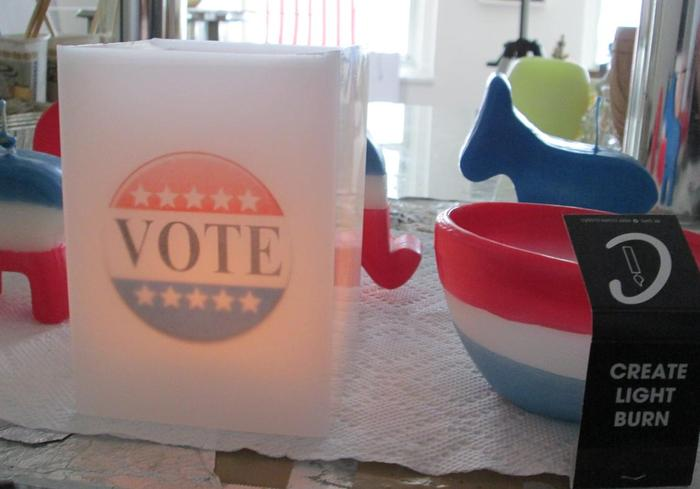 Flameless All-Wax Vote Candle, tea light lit inside (and Wick+Wax Matchbook)