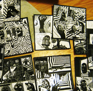 some scratchboard pages scattered on the floor
