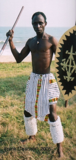 Teacher in a warrior dance costume.
