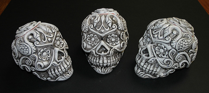 These Signed and Numbered Limited editions hand made ceramic Sugar Skulls are the ultimare reward! I will hand make one just for you with your name carved into the bottom if you wish. These Skulls are 4 inches tall and 5 inches long.