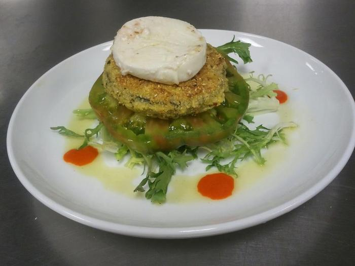 Local cornmeal encrusted eggplant and heirloom tomato Napoleon with marinated fresh mozzarella and red pepper coulis ; photo provided by Caroline Morrison