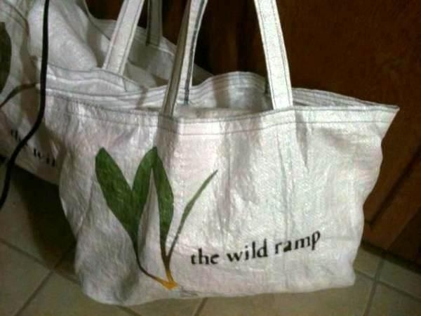 Our popular upcycled shopping bags!  Each of these is made from a 100 pound feed sack (donated by our farmers) and sewn into a shopping bag by our energetic volunteers!  Each hand-crafted and hand-stenciled bag takes over an hour to create.