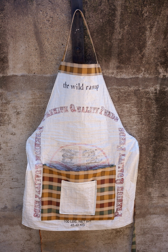 Our exclusive aprons- made by volunteers from feedbags donated by farmers.  These are NOT for sale- the only way to get one is by donating!