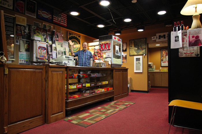 Max Morey behind the counter in the Crescent Theater lobby