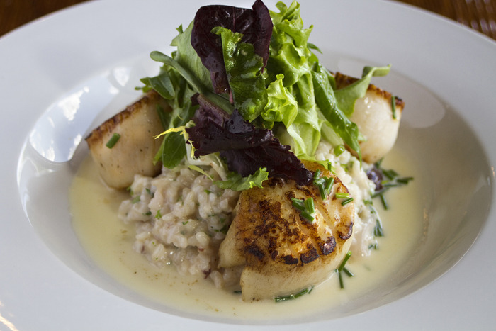 Pan Seared Scallops over kalamata olive risotto and local mixed greens