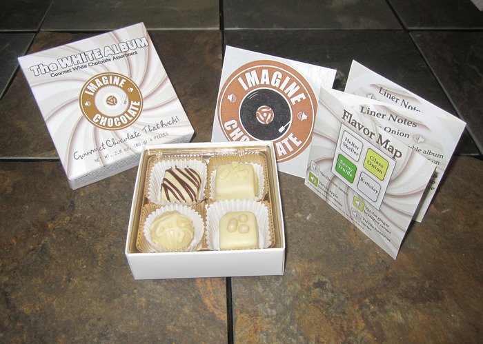 "Each themed assortment of Imagine Chocolate includes 4 different flavors, an Imagine Chocolate sticker, a Flavor Map, and Liner Notes -- a Pop Culture history lesson on the songs and artists that inspired our flavors (pictured ""The White Album"")."