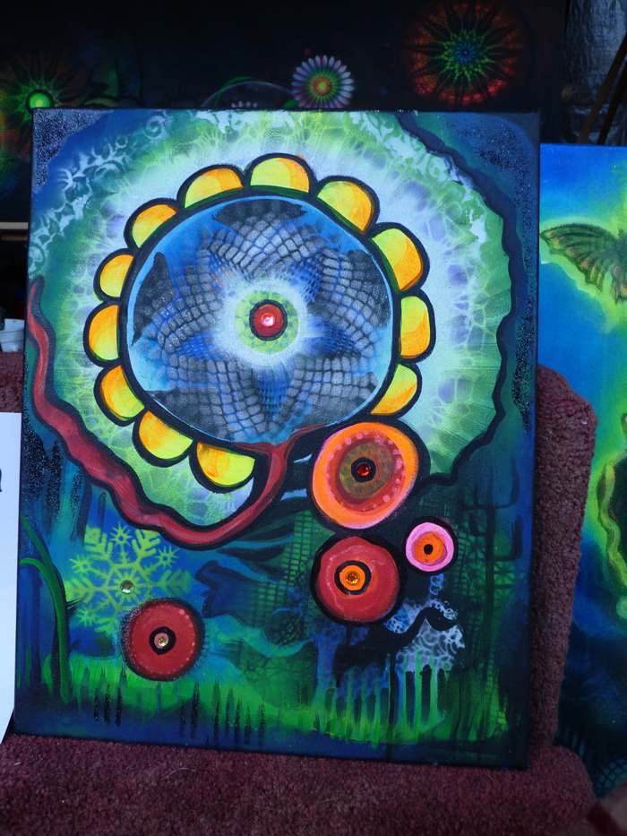 Above is an 11x17 inch blacklight painting, painted at the Shangri-La Festival in MN.