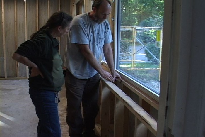 Me (left) with business owner explaining double stud wall in 7,000 sq ft retrofit.
