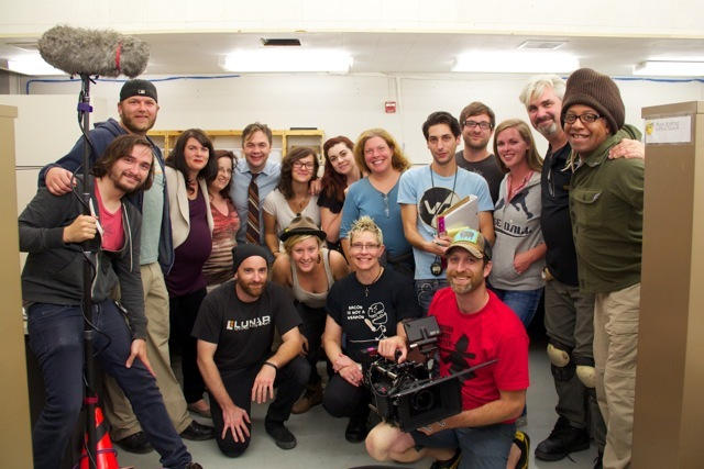 Behind the scenes photo of cast and crew