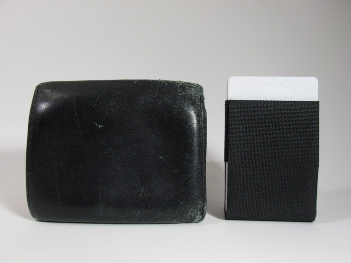 Slider next to a tri-fold wallet